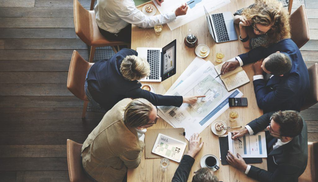 Businesspeople deciding how to overcome skills gaps
