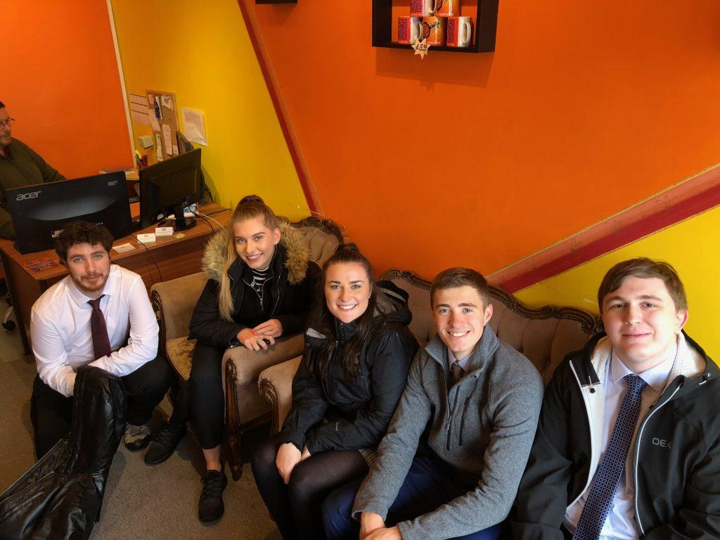 Hopewiser graduates in a high street escape room